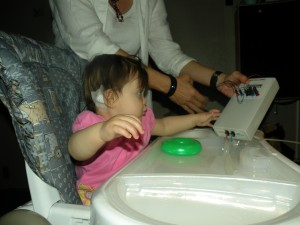 Mia checking her brain waves during a hearing study.