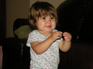 Zoe doing baby sign language