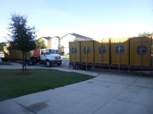 The trucks arriving with the crates filled with all of our belongings.