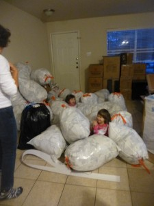 Surprising their Nanny by hiding in the packing materials.