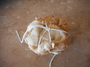 1) The ball of bread tied with string